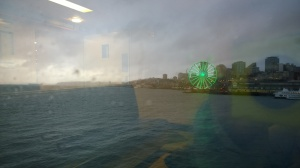 Managed to snap the picture of the Seattle Great Wheel with the unintentional effect showcasing the inside of the Washington State Ferry
